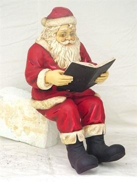 Papá Noel leyendo un libro en Navidad-Trabalibros
